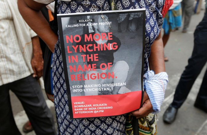 A woman holds a placard during a protest against the lynching of Tabrez Ansari by a mob, in Kolkata on June 26, 2019. REUTERS