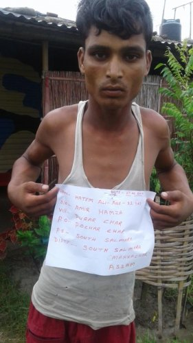 An Indian cattle smuggler arrested by BSF personnel near India-Bangladesh border in South Salmara district in western Assam on Thursday. Photo credit: BSF