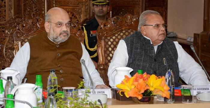 Union Home Minister Amit Shah chairs a meeting to review the security arrangements for the annual Amarnath Yatra, in Srinagar, Thursday, June 27, 2019. Jammu and Kashmir Governor Satya Pal Malik is also seen. (PTI Photo)