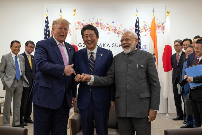U.S President Donald Trump jokes to the media about fist bumping with Japan's Prime Minister Shinzo Abe and India's Prime Minister Narendra Modi during a trilateral meeting on the first day of the G20 summit on June 28, 2019 in Osaka, Japan. Carl Court/Po