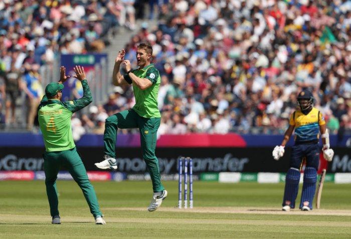 South Africa's Dwaine Pretorius celebrates taking the wicket of Sri Lanka's Kusal Mendis. Photo credit: Reuters