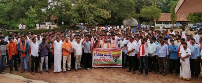 Members of VHP, Bajrang Dal stage a protest in Byndoor on Friday.