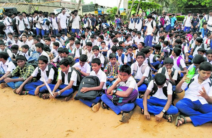 Students of Uppunda Government PU College stage a protest opposing the transfer of teachers.