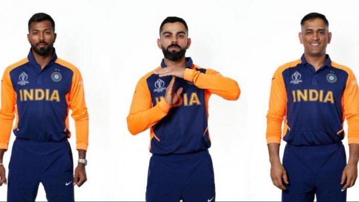 Hardik Pandya, Virat Kohli and MS Dhoni wearing India's new orange away jersey for their World Cup match against England(Twitter)