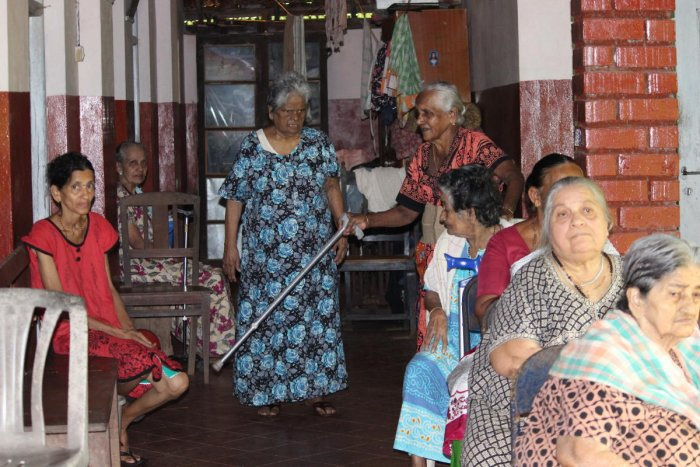 Residents of Mount Rosary Home in Moodbidri engaged in indoor and outdoor activities.