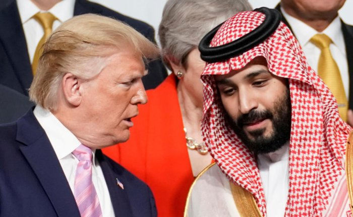 U.S. President Donald Trump speaks with Saudi Arabia's Crown Prince Mohammed bin Salman during family photo session with other leaders and attendees at the G20 leaders summit in Osaka, Japan, June 28, 2019. (REUTERS)