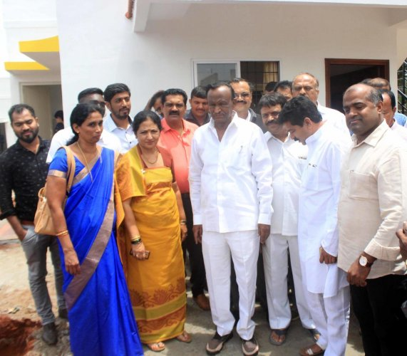 Housing Minister M T B Nagaraj inspects the houses constructed for calamity victims at Jambooru in Somwarpet.