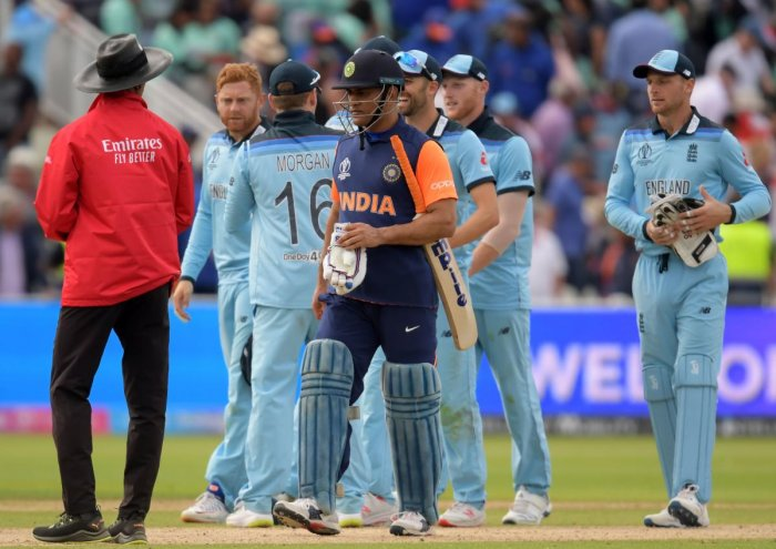 Mahendra Singh Dhoni walks off the field after the defeat in the group stage match against England at Edgbaston. Credit: Dibyangshu Sarkar/AFP