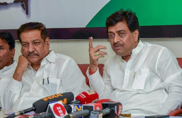 Former chief ministers Prithviraj Chavan and Ashok Shankarrao Chavan during Congress party press conference at Gandhi Bhavan. PTI file photo