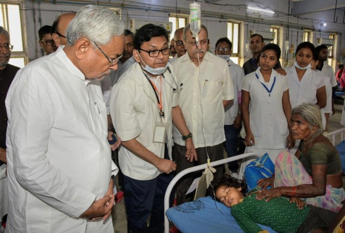 Bihar Chief Minister Nitish Kumar along with deputy CM Sushil Kumar Modi visits children suffering from Acute Encephalitis Syndrome (AES) at a hospital in Muzaffarpur district. (PTI File Photo)