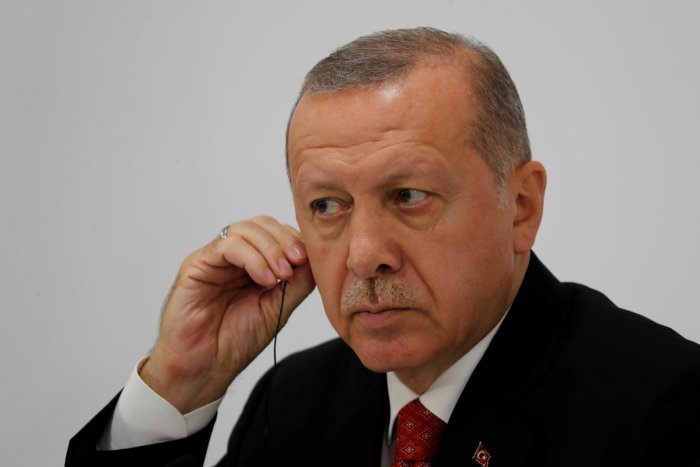 """It is out of the question for us to approach this issue positively,"" Erdogan told journalists while returning from the G-20 summit in Japan. (Reuters Photo)"