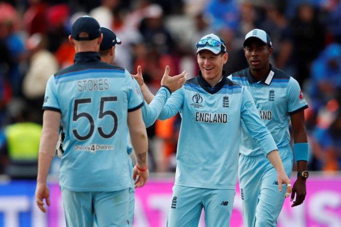 Cricket - ICC Cricket World Cup - England v India - Edgbaston, Birmingham, Britain - June 30, 2019 - England's Eoin Morgan celebrates with teammates after the match. Reuters