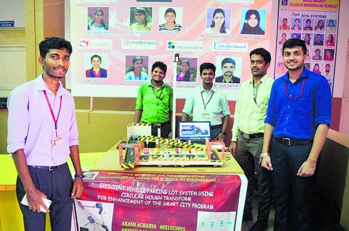 Students of Srinivas School of Engineering with their project on efficient vehicle parking lot system.