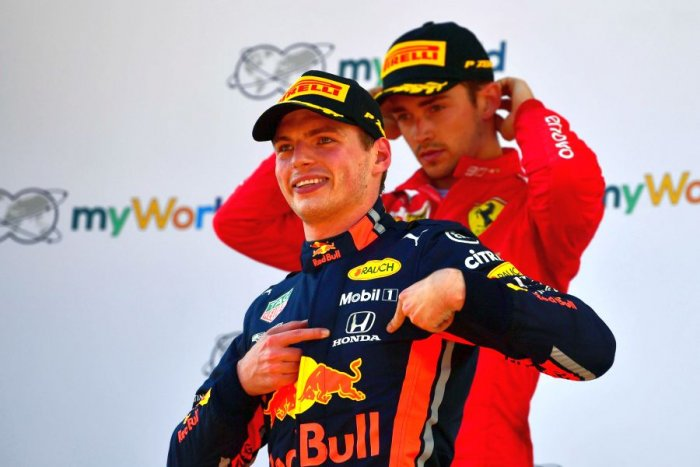 Charles Leclerc (in background) is a dejected man as Max Verstappen celebrates his Austrian GP win. Picture credit: AFP