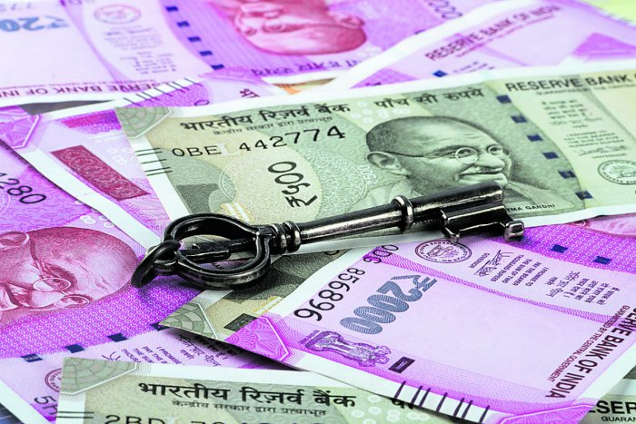 New Indian Rupees Currency with a Key. (Thinkstock Photo)