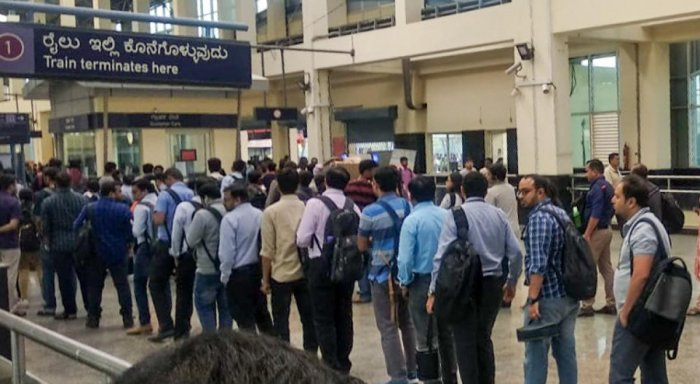 Passengers queue up at the Baiyappanahalli metro station following a glitch on the Purple Line on Monday.