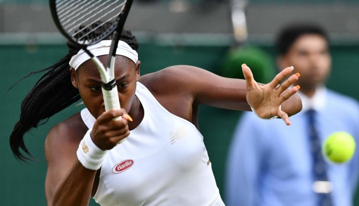 US player Cori Gauff returns the ball to US player Venus Williams during their women's singles first round match on the first day of the 2019 Wimbledon Championships. AFP