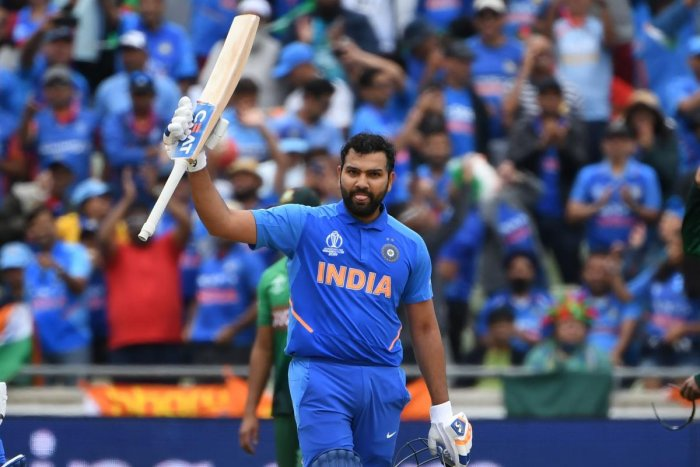 India's Rohit Sharma celebrates making his century during the 2019 Cricket World Cup group stage match between Bangladesh and India at Edgbaston in Birmingham, central England. AFP photo