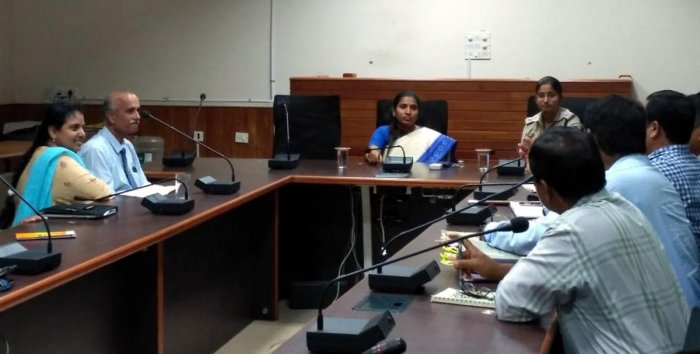 Deputy Commissioner Hephsiba Rani Korlapati chairs a meeting of government and administrative body officers in Udupi on Tuesday to discuss hassle-free traffic flow and parking areas.