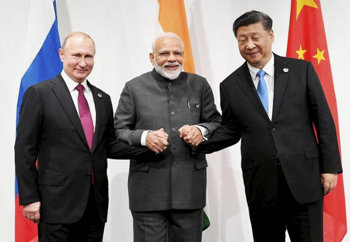Prime Minister Narendra Modi with Russian President Vladimir Putin (L) and Chinese President Xi Jinping at an informal meeting between Russia, India and China (RIC), on the sidelines of the G-20 Summit, in Osaka, Japan. PTI