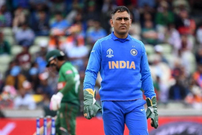 India's Mahendra Singh Dhoni gestures during the 2019 Cricket World Cup group stage match between Bangladesh and India at Edgbaston. Photo credit: AFP