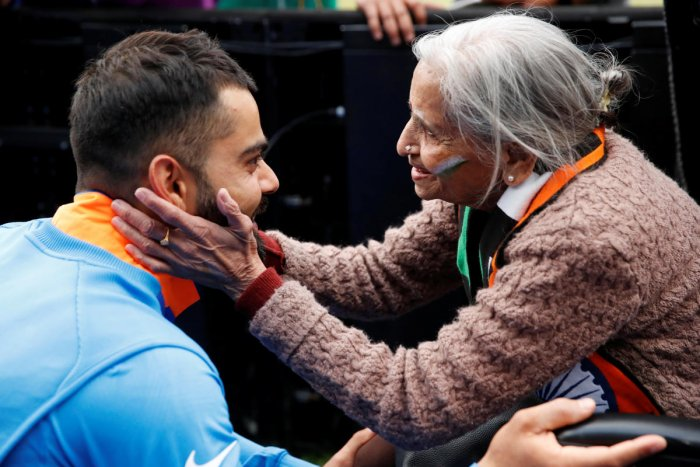 GRACIOUS SKIPPER India's Virat Kohli meets fan Charulata Patel at the end of the match against Bangladesh in Birmingham on Tuesday. Reuters