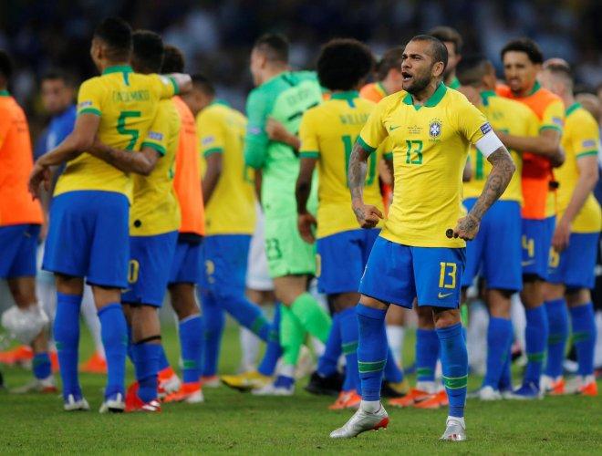Brazil's Dani Alves celebrates after winning the match against Argentina. (Reuters Photo)