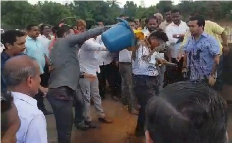 Screenshot from the video showing Nitesh Rane pouring mud over engineer.