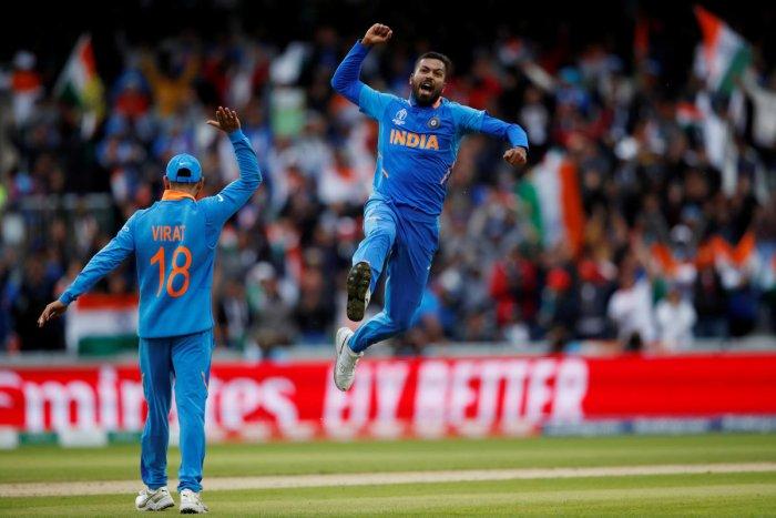 Hardik Pandya celebrates after taking the wicket of Pakistan's Shoaib Malik. Photo credit: Reuters