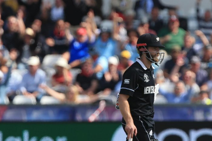 New Zealand's captain Kane Williamson walks off after losing his wicket for 27 during the 2019 Cricket World Cup. (AFP Photo)
