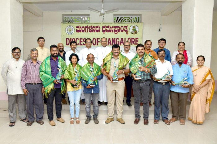Mangaluru Bishop Dr Peter Paul Saldanha felicitated forest officers, team leaders and volunteers for supplying saplings to 124 churches under the Mangalore Diocese at the Bishop's house on Wednesday.