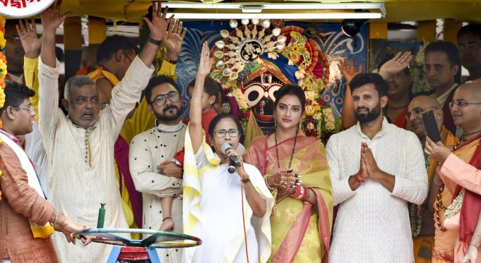 West Bengal Chief Minister Mamata Banerjee with newly elected Trinamool Congress MP and film actress Nusrat Jahan during Rath Yatra event organised by ISKCON, in Kolkata on Thursday. PTI photo