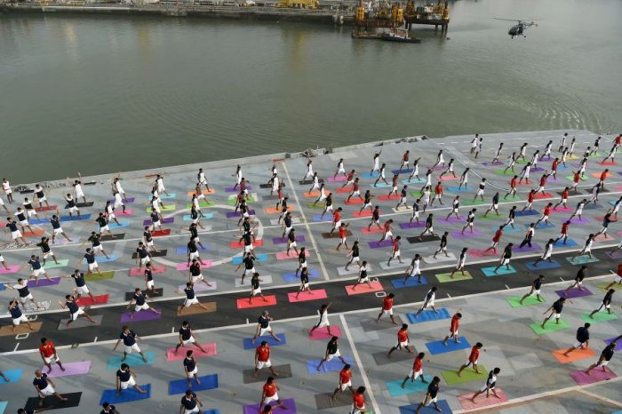 Indian armed personnel performing asanas on International Day of Yoga on June 21. Picture credit: AFP