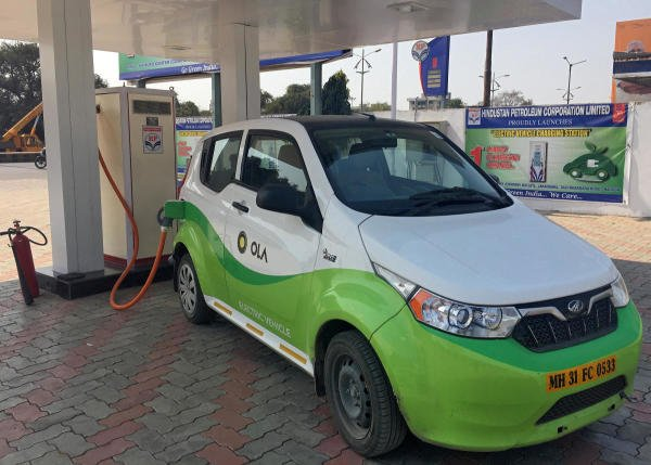 Mahindra's, e2oPlus, operated by Ola, is seen at an electric vehicle charging station in Nagpur. Reuters file photo//Aditi Shah