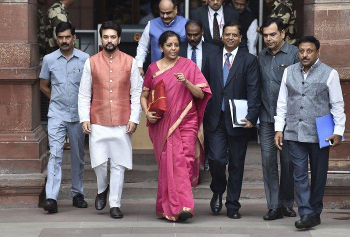 Finance Minister Nirmala Sitharaman, ahead of her maiden Budget speech, carried a 'bahi khata' (ledger) instead of a briefcase.(PTI Photo)