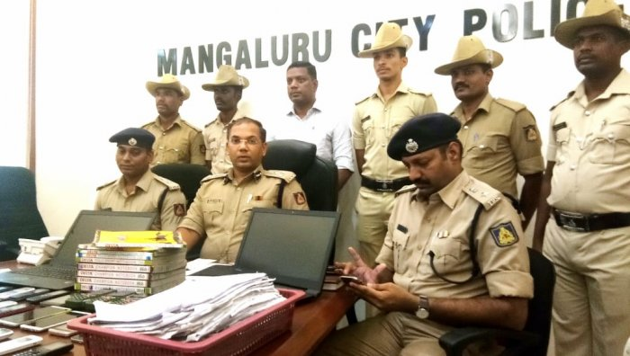 The Mangaluru City Police team which busted the online fraud case.