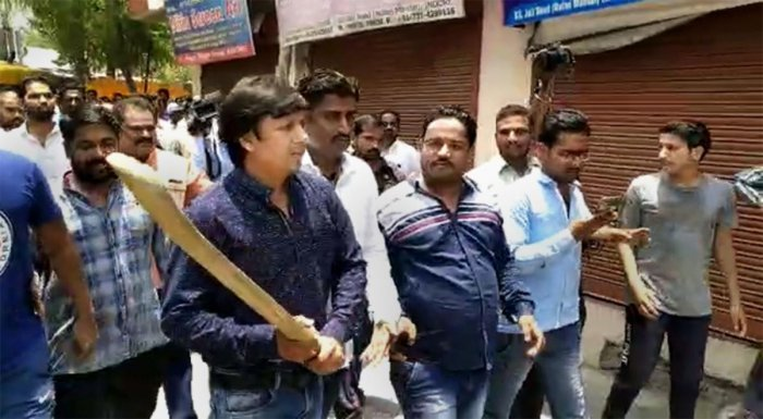 In this video still BJP MLA Akash Vijayvargiya is seen assaulting a civic official with a cricket bat in Indore, Wednesday, June 26, 2019. Vijayvargiya allegedly beat up the official for attempting to demolish a building of his supporter. (PTI Photo)