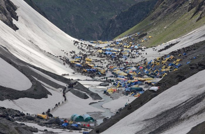 Hindu pilgrims arrive to worship at the holy cave of Lord Shiva in Amarnath, southeast of Srinagar, July 2, 2019. Picture taken July 2, 2019. REUTERS