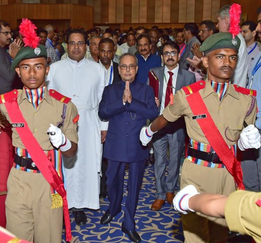 NCC students welcome former President Pranab Mukherjee at the valedictory of the golden jubilee celebrations of the Christ Deemed to be University on Thursday. DH photo/Ranju P