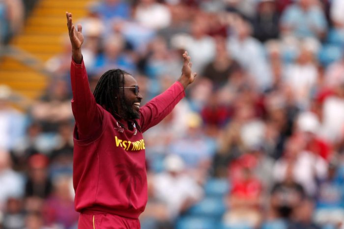 Chris Gayle celebrates the wicket of Afghanistan's Ikram Alikhil. (Reuters Photo)