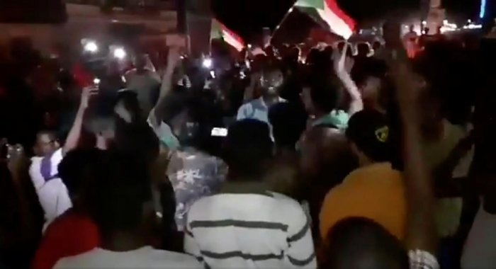 People celebrate and wave flags, after Sudan's ruling military council and a coalition of opposition and protest groups reached an agreement to share power during a transition period leading to elections, in Khartoum. (Sudan Congress Party/via Reuters)