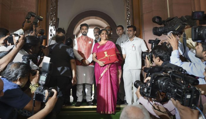 Finance Minister Nirmala Sitharaman and MoS Anurag Thakur arrive at Parliament to present the Union Budget 2019-20, in New Delhi, Friday, July 05, 2019. (PTI Photo)