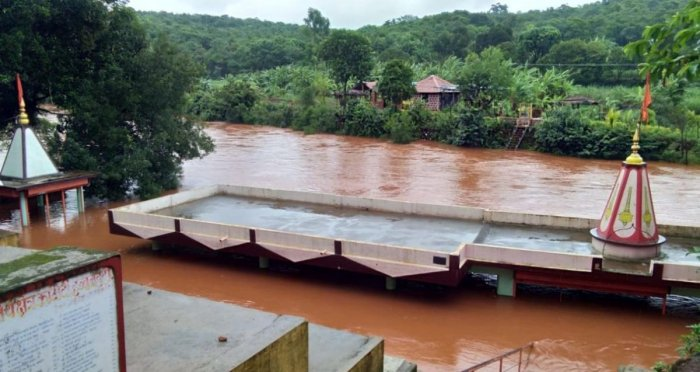 The Hanuman temple at Habbanatti village in Khanapur taluk of Belagavi district submerged in River Malaprabha following heavy rain in the Western Ghats region. DH Photo