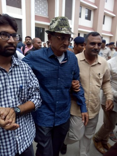 Bikhubhai ( in the middle middle), father of Amit Jethva, coming out of the court who is accompanied by independent MLA Jignesh Mevani.