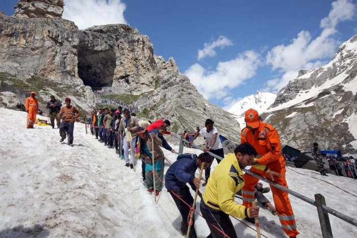 Hindu pilgrims leave the holy cave of Lord Shiva after worshipping in Amarnath. Reuters photo