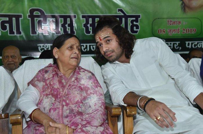 RJD senior leader Rabri Devi with party MLA Tej Pratap during 23rd foundation day function of Rashtriya Janata Dal party, in Patna. (PTI Photo)