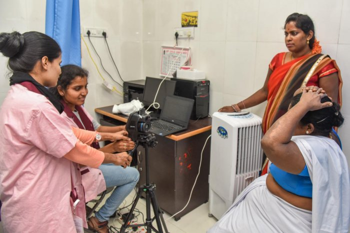 Medical lab technicians scan a woman during a breast cancer screening on H Siddaiah Road on Friday. DH PHOTO/S K DINESH
