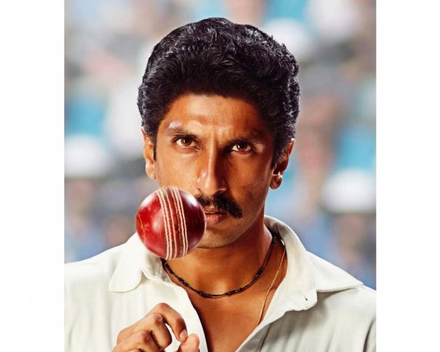 "On his 34th birthday, Ranveer Singh treated his fans with his first look as Indian cricket legend Kapil Dev from the upcoming film ""83""."