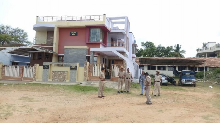 Police security near MLA K C Narayanagowda's house in KR Pet, Mandya district, on Saturday.