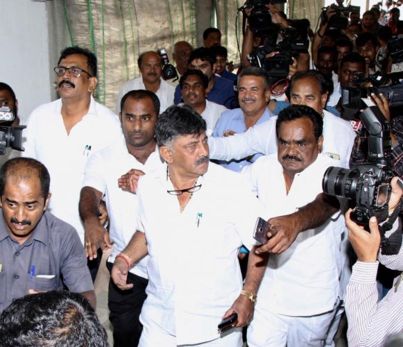 Minister D K Shivakumar arrives at Vidhana Soudha to convince the rebel Congress MLAs, in Bengaluru on Saturday.